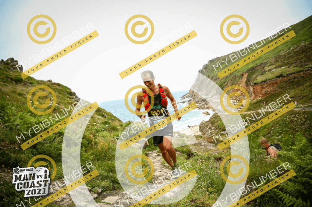Running Man vs. Coast 2021 on the South West Coast Path with My Bib Number logo on photo as you have to pay for them.