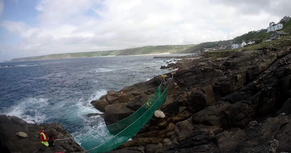 Man vs. Coast rope bridge over a rocky crevice.
